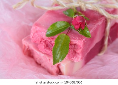 Rose Handmade Soap.Soap with Rose Extract. handmade soap  with roses on pink crumpled paper. Organic Vegetable Cosmetics Concept.Natural vegan soap with rose fragrance