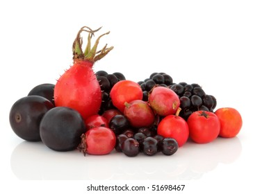 Rose hip, hawthorn, rowan berry, blueberry and blackcurrant fruit selection isolated over white background.