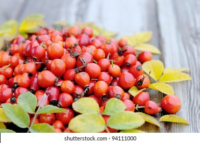 rose hips on a wooden table