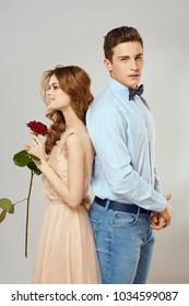 rose, holiday, young couple on a light background, eighth March