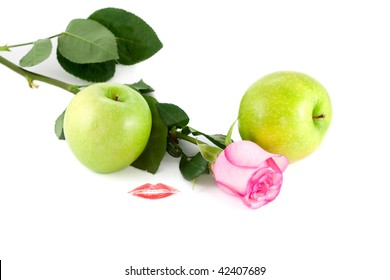 Rose, kiss and green apples on white background