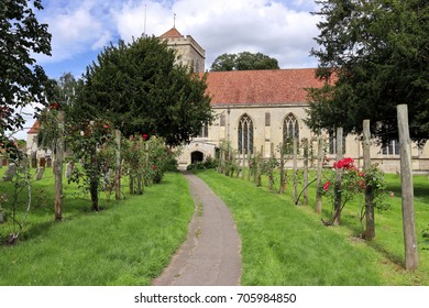 Rose lined path leading to Dorchester on Thames Abbey