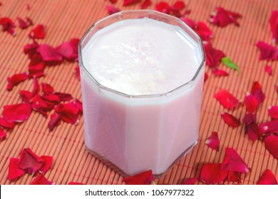 Rose milk drink prepared with rose petals and milk and served chill. Popular drink in India during summer.