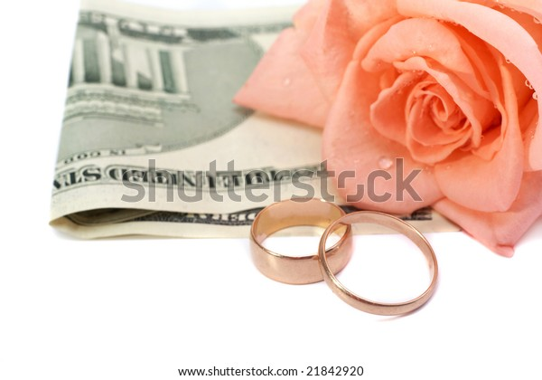 Rose, money and rings on a white background