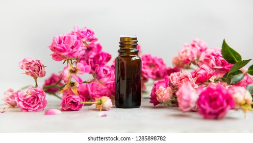 Rose oil bottle for aromatherapy and spa with roses flowers, spa setting