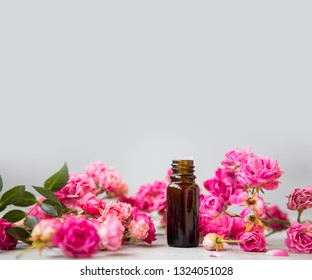 Rose oil. Spa and aromatherapy rose flowers essential oil bottle with copy space