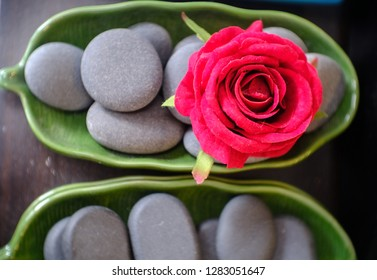 Rose on stones in a cup is massage accessories