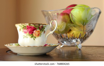 Rose pattern tea cup with Apples in Glass Bowl