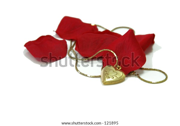 Rose petals and heart necklace.