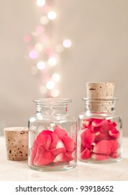rose petals in a jar with a cork top and bubbles coming out of it