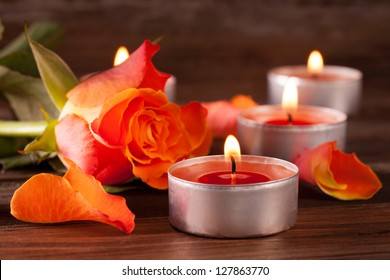 a rose with petals and tealights