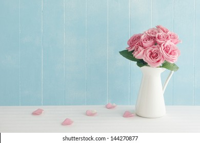 Rose placed on the desk in blue background