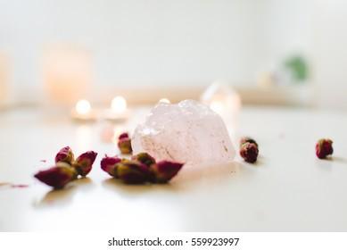 Rose quartz crystal with rose buds