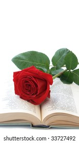 Rose of red color on pages of the book with verses.