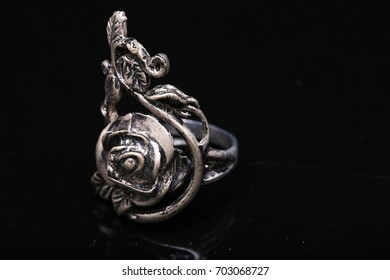 rose ring,silver ring rose on black background
