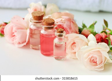 Rose spa setting aromatic water in bottles natural freshness soft delicate flowers feminine beauty