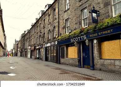 Rose street in Edinburgh, famous lane of pubs and bars boarded up and deserted street during the coronovirus pandemic in UK. Edinburgh City centre, scotland UK. may 2020