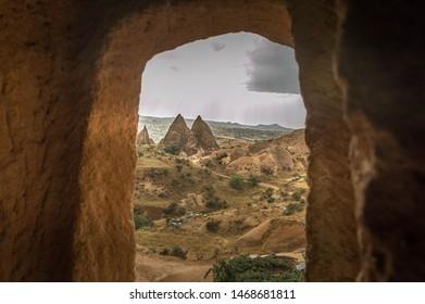 Rose Valley seen through a window, in Kapadokya, Turkey