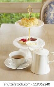 rose vanilla tea with scones on two tiered tray.