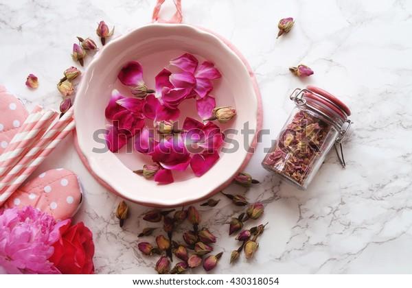 Rose water and rose petals