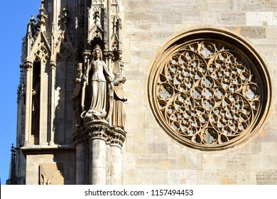 Rose window, an architectural element, on a wall of St. Stephen's Cathedral (Stephansdom) in Vienna, Austria. A romanesque/gothic-style Roman Catholic church, built during the Middle Ages.