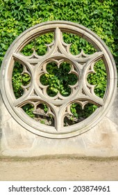 Rose window made of stone at place de vosge. rose window, also called wheel window, in Gothic architecture, decorated circular window, often glazed with stained glass,Paris,France,Europe