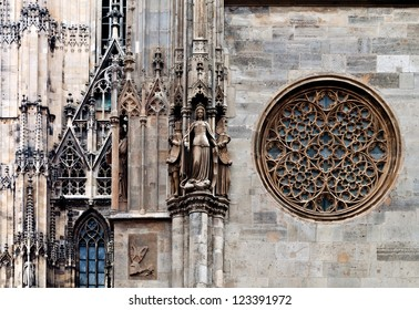 Rose window, maiden statue and other details of the famous cathedral of saint Stephan in Vienna, Austria