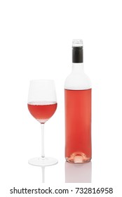 Rose wine bottle with filled wineglass, isolated on white with reflexion and clipping path