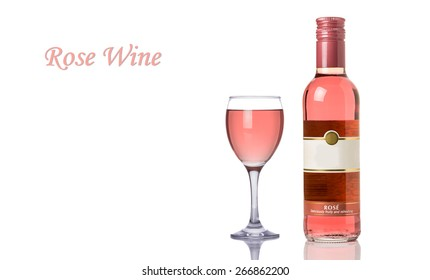 Rose Wine Bottle and a Full Glass Isolated on a White Background. Copy Space.