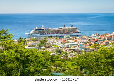 Roseau, Dominica with cruise ship in the harbor.
