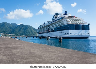 ROSEAU,DOMINICA-AUGUST 8 ,2011 : Celebrity Summit luxury cruise ship, with capacity of 2,450 passengers, is docked at Roseau bay.