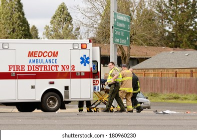 ROSEBURG, OR, USA - JANUARY 13, 2014:  Emergency responders at the scene of a motorcycle vs car at a busy intersection that left the rider with serious injuries.