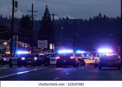 ROSEBURG OREGON  - DECEMBER 17: Police cars at incident where a person who shot at officers and then barricaded himself in a hotel in Roseburg Oregon, December 17, 2012