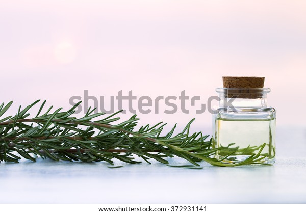 Rosemary aromatherapy essential oil  in bottle on sunset