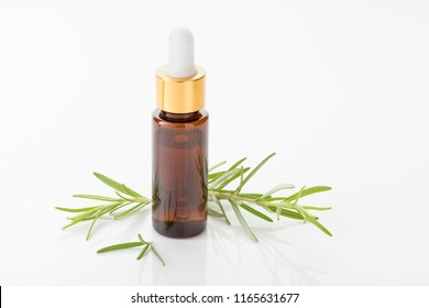 Rosemary essential oil isolated on white background. Rosmarinus officinalis