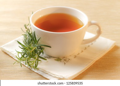 Rosemary infusion in a cup.Selective focus.