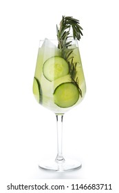 Rosemary Jin Tonic Cocktail with Cucumber and Ice Isolated on White Background. Green Sweet Iced Restaurant Beverage with Sliced Cucumbers, Lime Lemonade, Mint and Sprig of Rosemary Close Up