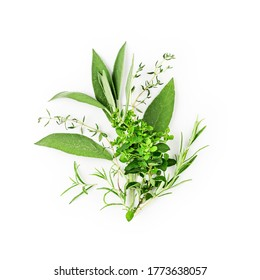 Rosemary, marjoram, sage and thyme arrangement. Creative composition with fresh herbs bunch on white background. Top view, flat lay. Floral design. Healthy eating and alternative medicine concept
