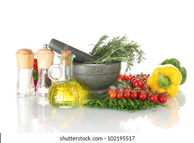 rosemary in mortar, oil in jar, paprika, tomatoes cherry, and green onion isolated on white