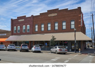 Rosenberg, Tx, USA - 6th March 2015An Old red brick building in Rosenberg, Texas, this building containing a Bakery and Soda Fountain Milk Bar.