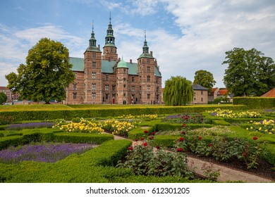 Rosenborg castle, Copenhagen. Sunny summer day view. Blooming terraces at the foreground.