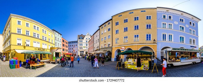 Rosenheim, Germany - April 11: people at the weekly farmers market at the old town of Rosenheim on April 11, 2020