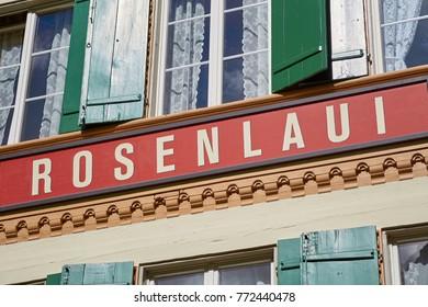 ROSENLAUI VALLEY, BERNESE OBERLAND, SWITZERLAND - SEPTEMBER 2017: Rosenlaui sign on the 18th century historic Rosenlaui mountain hotel - early Swiss alpine tourism.