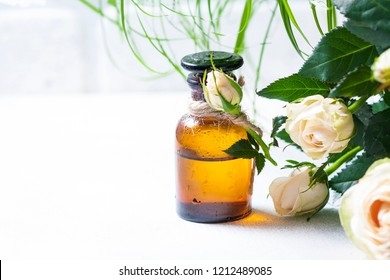 Roses aroma oil, spa and aromatherapy, selective focus