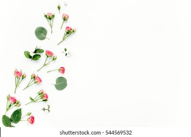 roses, eucalyptus branches, leaves isolated on white background. flat lay, overhead view