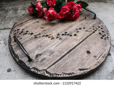roses on an old wooden tray