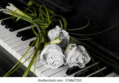 Roses on piano - condolence card, with deepest sympathy
