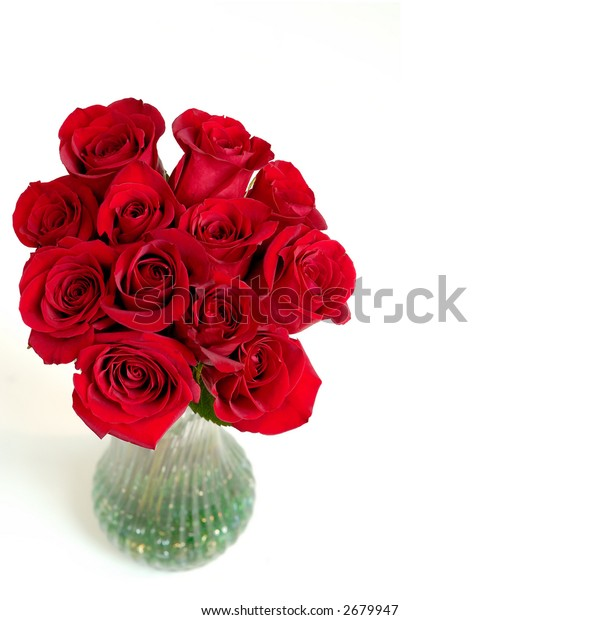 Roses Are Red - A vase of beautiful red roses on a white background with space for copy.