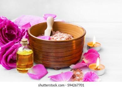 Roses spa setting with bath salt, roses flowers, bath rose oil, still life set