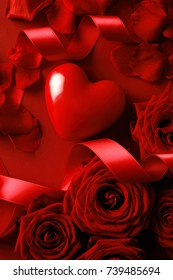 roses and valentine red heart on red background. Valentine's Day